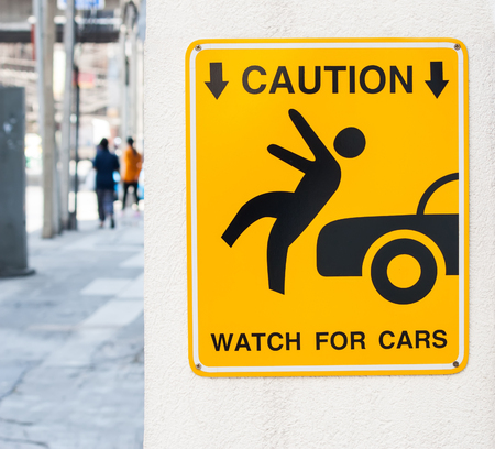 Caution, watch for cars photo