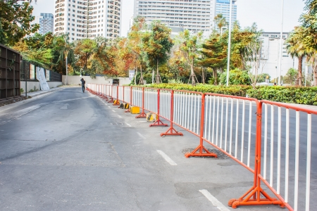 traffic fence on a parking lot in the park  photo