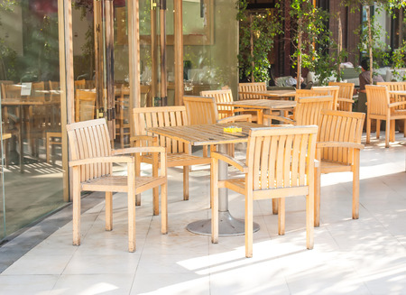 Wooden chairs at coffee shop
