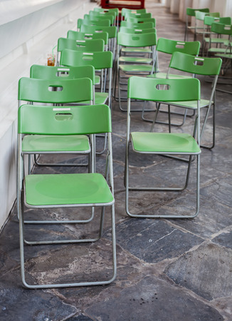 green folding chair in the temple photo
