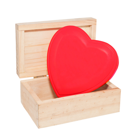 a wood box contains red heart shape decoration.