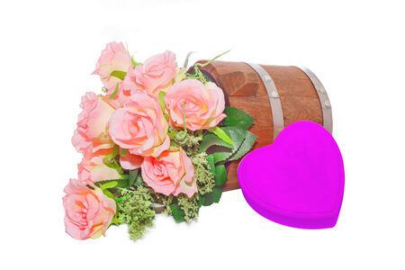 Summer flowers in wooden bucket and heart  on white background