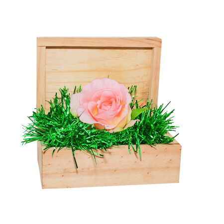 a wood box contains pink flower Stock Photo
