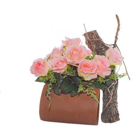 flowers in leather bag on white background