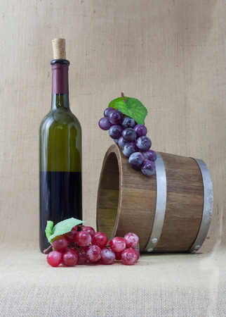 Red wine and grapes in vintage setting photo