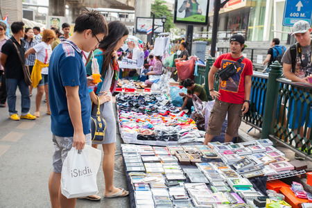 protestor: BANGKOK - Feb 16: Unidentified tourists walk and shop  along a road in Rajphasong area on Feb 16, 2014 in  Bangkok, Thailand. The protestor sold everything in  Rajphasong area.