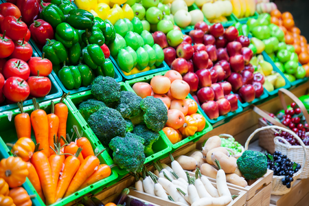 vegetable and fruits at a market. Imagens