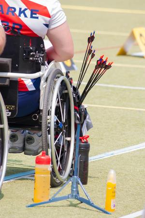 paraplegic: BANGKOK ,THAILAND - MARCH 15: Unidentified paraplegic archers with his arrows . in 1st Asian Archery  Grand Prix 2014  , on March 15, 2014 in Bangkok, Thailand.