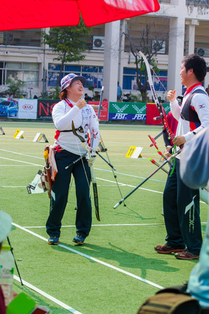 BANGKOK ,THAILAND - MARCH 15: Unidentified archers in happy action with a good point.  , on March 15,  2014 in Bangkok, Thailand.