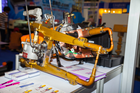 fettler: BANGKOK ,THAILAND - MAY 18 Hand hold Spot Welding Machine in ASEAN s Leading Industrial Machinery and Subcontracting  Exhibition 2014,on May 18, 2014 in Bangkok, Thailand  Editorial
