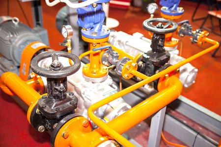 BANGKOK - JUNE 4 : steam valves and other pressure equipment at Renewable Energy Environmental Technology on June 4,2014 in BITEC ,Bangkok, Thailand. 新聞圖片