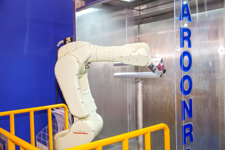 BANGKOK - JUNE 22 :Robotic working industrial hand at Manufacturing Expo 2014 on June 22,2014 ,Bangkok, Thailand.