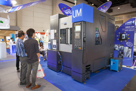 BANGKOK - JUNE 22 :Unidentified people interesting with cnc milling cutting machine at Manufacturing Expo 2014 on June 22,2014 ,Bangkok, Thailand.