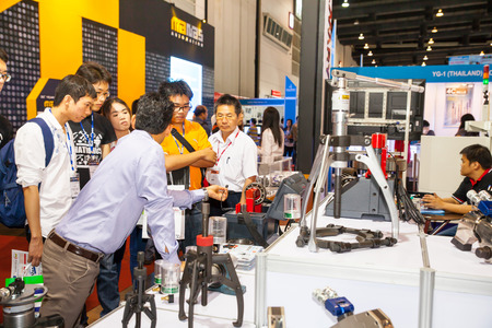 BANGKOK - JUNE 22 :Unidentified people interesting with Clamp and at Manufacturing Expo 2014 on June 22,2014 ,Bangkok, Thailand.