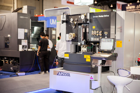 BANGKOK - JUNE 22   CNC milling machine milling and control panel  at Manufacturing Expo 2014 on June 22,2014 ,Bangkok, Thailand