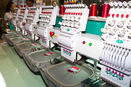 manufacturers: BANGKOK - JUNE 28  Industrial Embroidery Machine at Garment Manufacturers Sourcing 2014 on June 28,2014 in BITEC ,Bangkok, Thailand
