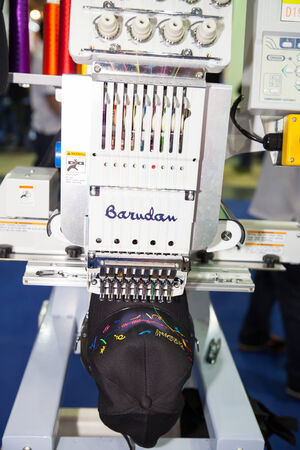 manufacturers: BANGKOK - JUNE 28  Cap on embroidery machine at Garment Manufacturers Sourcing 2014 on June 28,2014 in BITEC ,Bangkok, Thailand