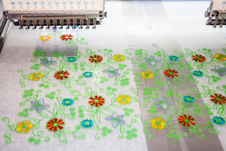 manufacturers: BANGKOK - JUNE 28  Embroidery machine in Textile   Industry at Garment Manufacturers Sourcing 2014 on June 28,2014   in BITEC ,Bangkok, Thailand