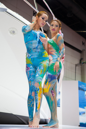 body paint: BANGKOK - AUGUST 16 :An unidentified female show body paint at CRANCHI booth at Big Motor Sale 2014 on June 16,2014 in BITEC ,Bangkok, Thailand. Editorial