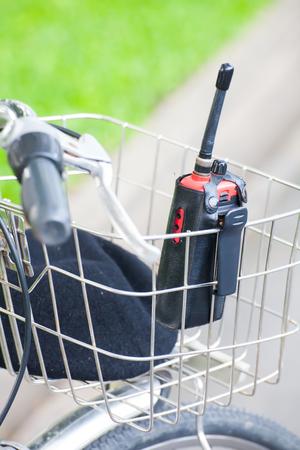 radio unit: walkie-talkie in bicycle basket