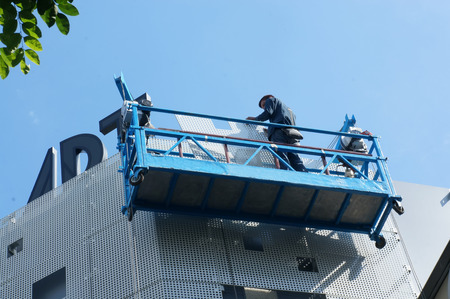 worker working at height building photo