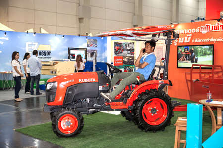 agronomics: BANGKOK - SEPTEMBER 27 :New tractor at Thailand International Logistic  Fair 2014 on Sep 27,2014 in BITEC ,Bangkok, Thailand.