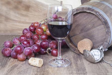 sauvignon blanc: Wine glasses with grapes, against oak barel still life.