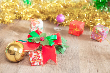 twelve month old: Christmas gift boxes and ribbon over wooden background Stock Photo