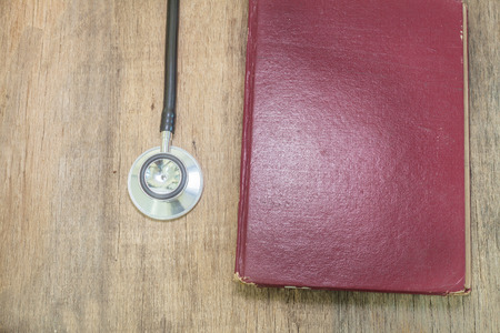 hardback: Stethoscope on old hardback books