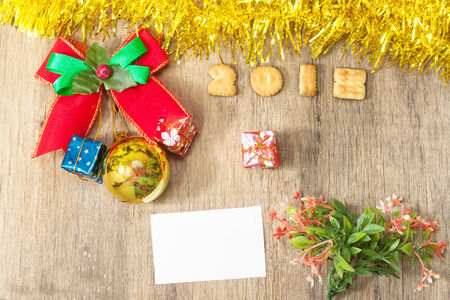 twelve month old: Christmas gift boxes and white note over  wooden background