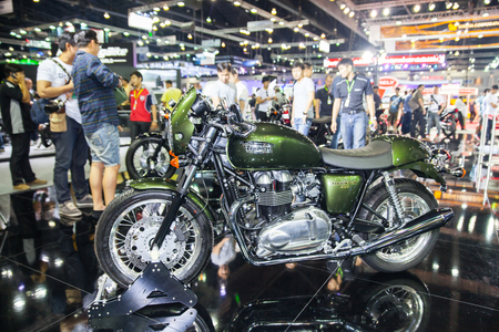 scrambler: NONTHABURI - DESEMBER 4 :TRIUMPH Thruxton 900  motorcycle  on display at MOTOR EXPO 2014 on  Dec 4,2014 in Nonthaburi, Thailand. Editorial