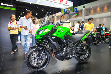 scrambler: NONTHABURI - DESEMBER 4 :KAWASAKI Versys 1000  cc motorcycle  on display at MOTOR EXPO 2014  on Dec 4,2014 in Nonthaburi, Thailand.