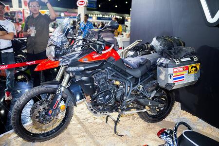 scrambler: NONTHABURI - DESEMBER 4 :TRIUMPH Tiger  motorcycle  on display at MOTOR EXPO 2014 on  Dec 4,2014 in Nonthaburi, Thailand.
