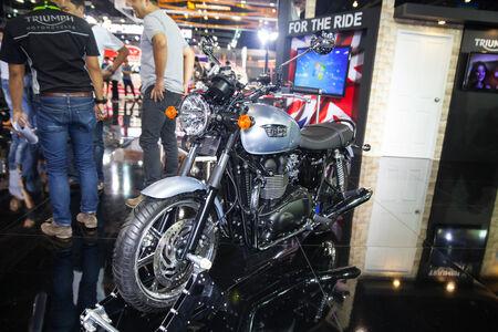 nonthaburi: NONTHABURI - DESEMBER 4 :TRIUMPH T100  motorcycle  on display at MOTOR EXPO 2014 on  Dec 4,2014 in Nonthaburi, Thailand.