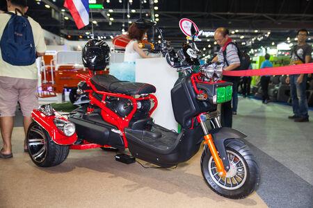 nonthaburi: NONTHABURI - DESEMBER 4 :UDA  Eletric scooter motorcycle on display at MOTOR EXPO 2014 on Dec 4,2014 in Nonthaburi, Thailand. Editorial