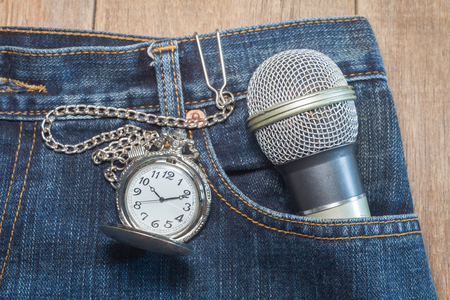 pocket watch in pocket of jeans photo