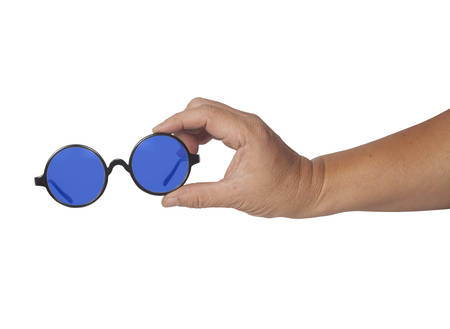bifocals: Hand holding glasses isolated in white  Stock Photo
