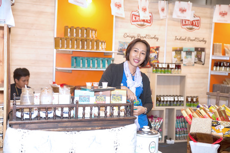exhibition crowd: BANGKOK ,THAILAND - JANUARY 31: Unidentified people interest with food and beverage booth in Made in Thailand in Focus 2015, on January 31, 2015 in Bangkok, Thailand.