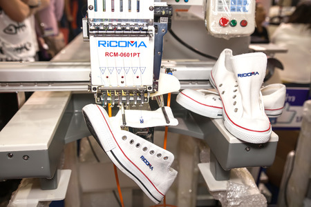 BANGKOK ,THAILAND - FEBRUARY 7: Shoes on embroidery machine at THAILAND  Industrial Fair 2015 And Food Pack Asia 2015 on February 7, 2015 in  Bangkok, Thailand.