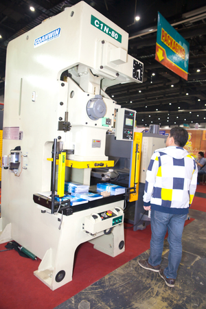 packer: BANGKOK ,THAILAND - FEBRUARY 7: Unidentified people interesting with book  packer machine At THAILAND Industrial Fair 2015 And Food Pack Asia 2015 on  February 7, 2015 in Bangkok, Thailand.