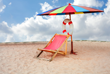 idling: Beach chairs with umbrella isolate