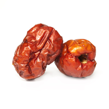 Red dried jujube on white background photo