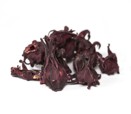 dried hibiscus sabdariffa or roselle fruits on  white. photo