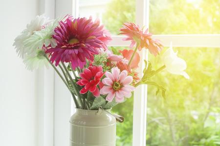 glass vase: Flowers in glass vase near the window Stock Photo