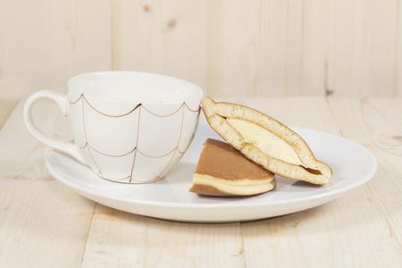 teacake: Dorayaki, Japanese Sweet  Pancakes on Wooden Table Stock Photo