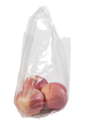 expedient: Apples in plastic bag isolated