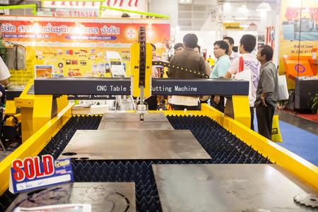 skilled operator: BANGKOK ,THAILAND - MAY 16: CNC Controller machines display at  Intermach-Subcon Thailand 2015, on MAY 16, 2015 in Bangkok,  Thailand.