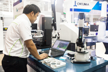 measuring instrument: BANGKOK ,THAILAND - MAY 16: Unidentified people use Measuring  instrument for quality inspection in Intermach-Subcon Thailand  2015, on MAY 16, 2015 in Bangkok, Thailand. Editorial