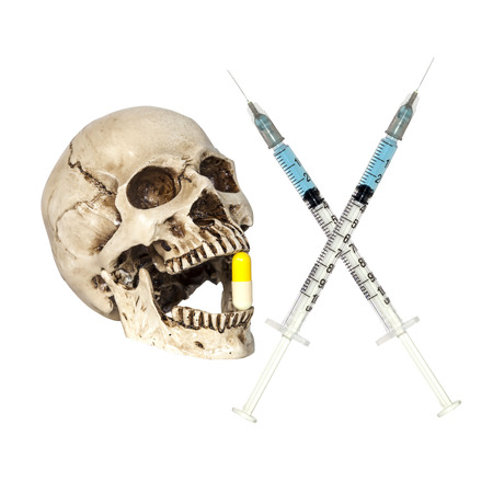 unbranded: Syringe and human skull isolated over white background.