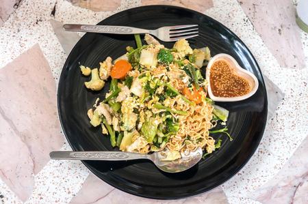 stir fry: noodle stir fry with vegetable ,Thai name is Sookie.